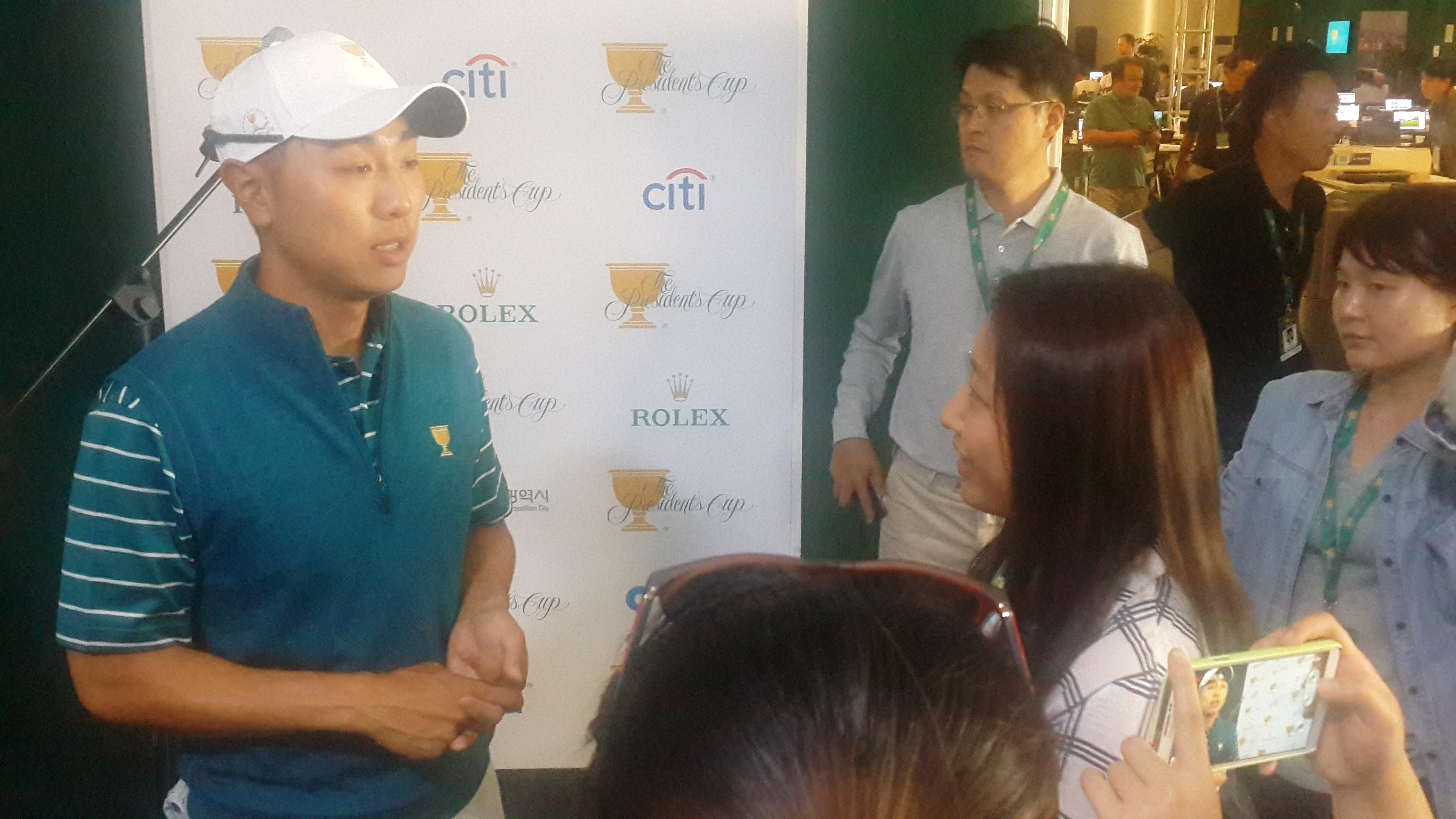 Sarah Choi, Center Right, Interviews Korean Golfer Sangmoon Bae At The Presidents Cup Press Conference On Oct. 6, 2015 In Songdo, South Korea. Photo Credit: Cijournalism.org.