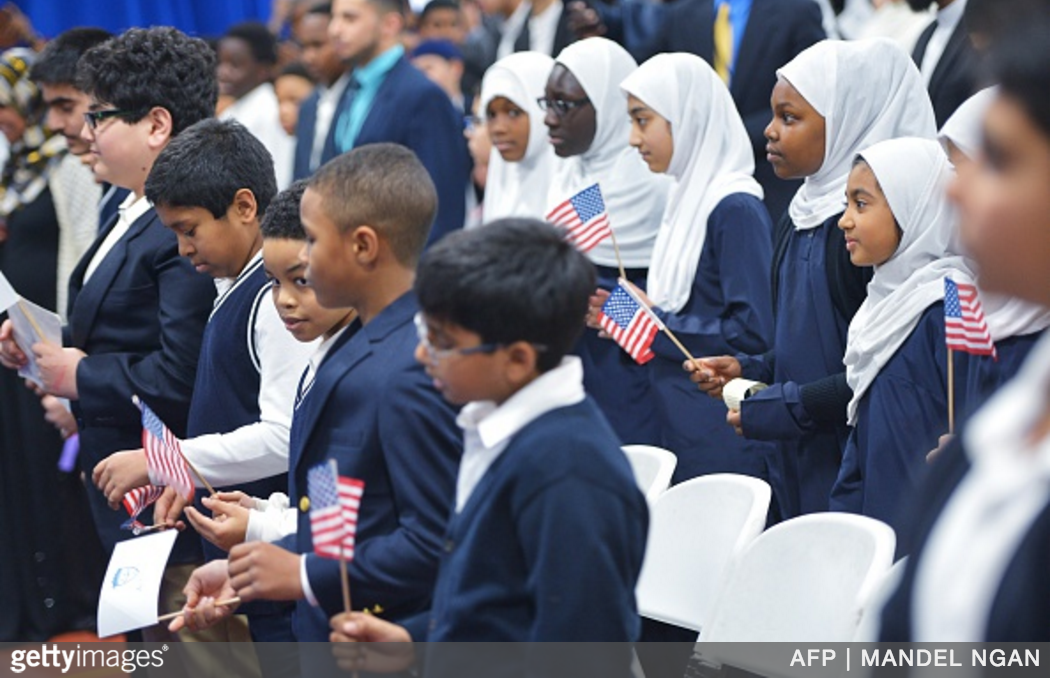 "Photo: Children Hold US Flags As President Barack Obama Speaks In An Overflow Room During A Visit To The Islamic Society Of Baltimore, In Windsor Mill, Maryland On Feb. 3. Obama Offered An Impassioned Rebuttal Of ""inexcusable"" Republican Election Rhetoric Against Muslims Wednesday, On His First Trip To An American Mosque Since Becoming President Seven Years Ago. MANDEL NGAN/AFP/Getty Images Via Camayak."