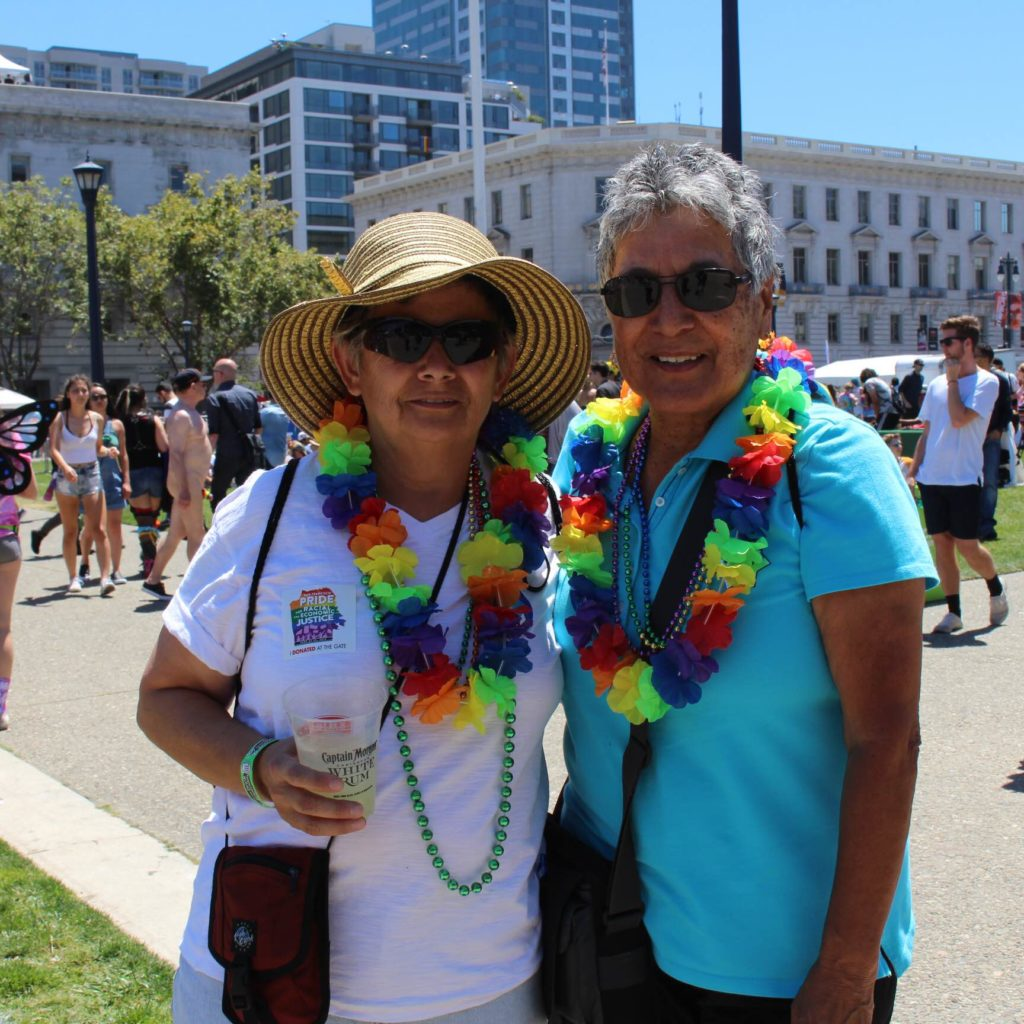 Maria Hasbun, 54, And Josie Mattos, 68, Walk Around The SF Pride Festival. The Two Planned To Stay For The Entirety Of The Weekend.