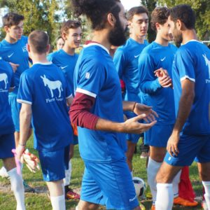 Soccer game unites American School of Paris, asylum seekers
