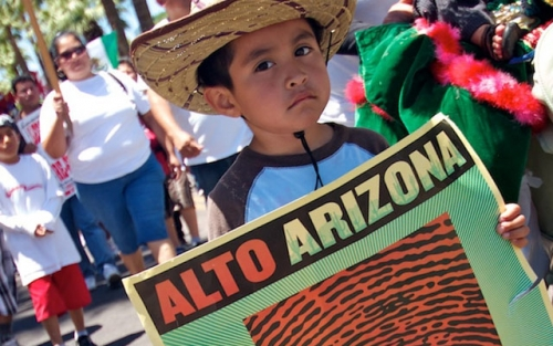 A Boy Holds An Image Of A Fingerprint During A Protest Against Senate Bill 1070 In Phoenix, Arizona, On May 29, 2010. Photo By Evan Finn On Flickr/Creative Commons 2.0.