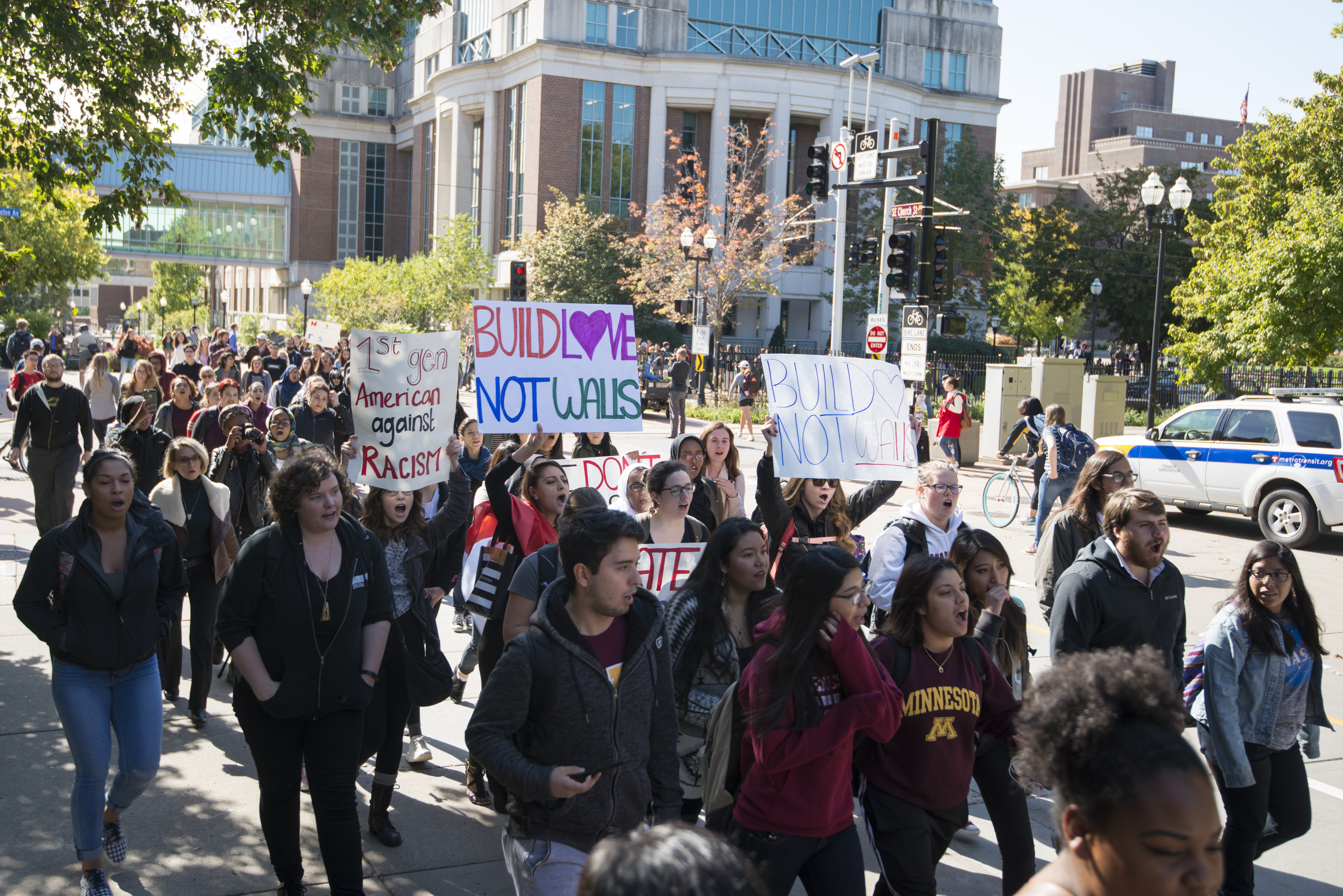"Minneapolis, Minnesota October 6, 2016 About 200 Protesters Met Outside Coffman Memorial Union To Protest Episodes Of Racism And Bigotry On Campus. The Trigger Of The Protest Was The Painting Of A Mural By The College Republicans Student Group Prominently Displaying The Words ""build The Wall"", A Slogan Of Presidential Candidate Donald Trump. Protesters Denounced The Mural As Hate Speech, Saying It Targeted Minorities And Immigrants. University President Eric Kaler Acknowledged The Mural Was Offensive But Also Condemned The Anti-Trump Graffiti That Has Since Covered The Mural. The Protesters Voice A Number Of Complaints About President Eric Kaler, Such As Allowing The Washington Redskins To Play The The University And His Lack Of Concern For Students Of Color. 2016-10-06 This Is Licensed Under A Creative Commons Attribution License. Give Attribution To: Fibonacci Blue/Wikimedia Commons"