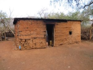 The house of a student in Kimuka Primary School, made with dried mud and sticks. The rooms inside were full of smoke and dust due to an oven used to cook food and burn fuel. Photo by Liam Carothers.